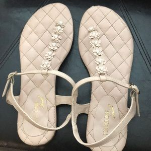 light pink sandals with pearl studded flowers